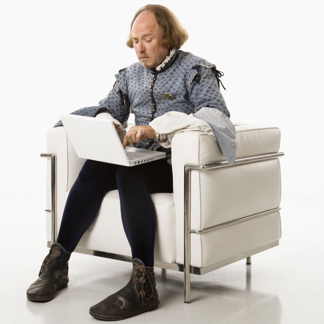 dreamstime_xxl_2678555 Shakespeare actor on laptop and modern chair