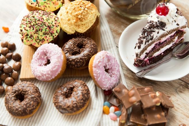 dreamstime_xxl_55594109 Eat what you want day food donuts candy black forest cake and more